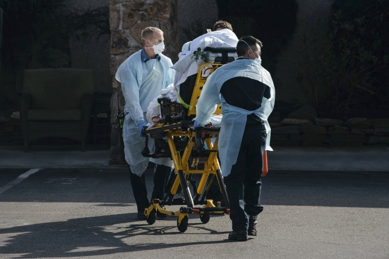 Image: A patient is removed from Life Care Center of Kirkland, a nursing home in Kirkland, Wash., Feb. 29, 2020. (Grant Hindsley/The New York Times)