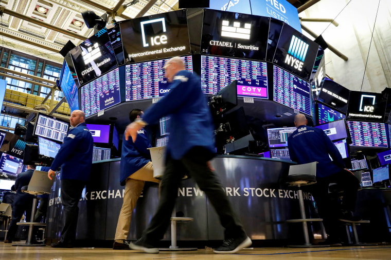 Image: Traders work on the floor at the NYSE in New York