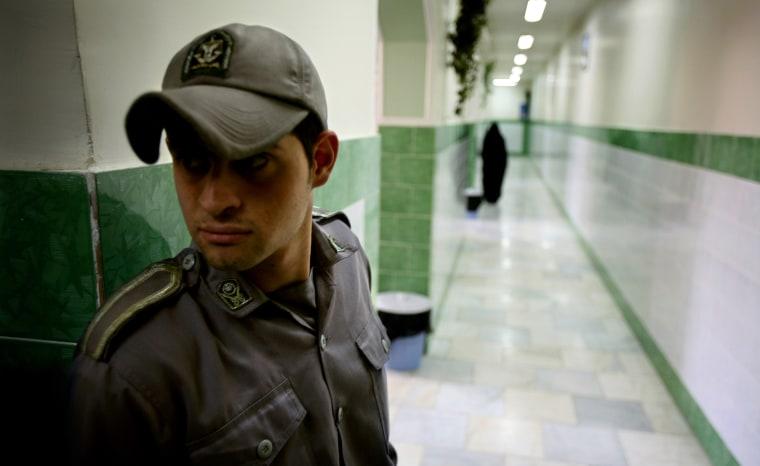 Image: Prison guard stands along corridor in Tehran's Evin prison