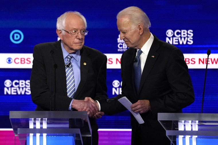 Image: Democratic 2020 U.S. presidential candidates Senator Bernie Sanders shakes hands with former Vice President Joe Biden after the tenth Democratic 2020 presidential debate at the Gaillard Center in Charleston, South Carolina