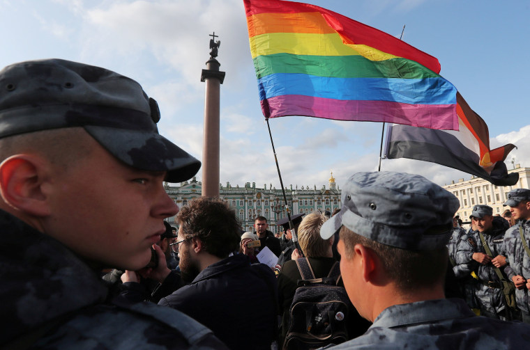 """Image: Law enforcement officers block participants of the LGBT community rally \""""X St.Petersburg Pride\"""" in central Saint Petersburg, Russia"""