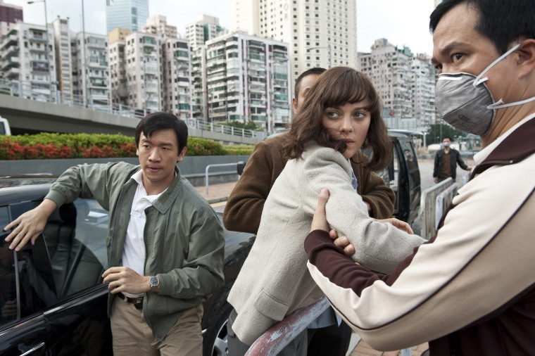 """Chin Han, left, as Sun Feng and Marion Cotilard as Dr. Leonora Orantes in """"Contagion."""""""