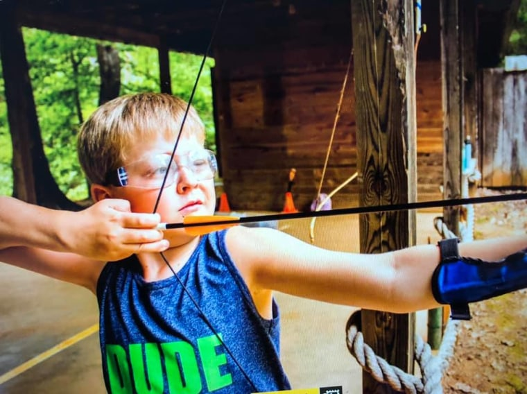 Author Jennifer Folsom's son, Anderson, in 2019 doing archery at Camp Friendship in Palmyra, VA.