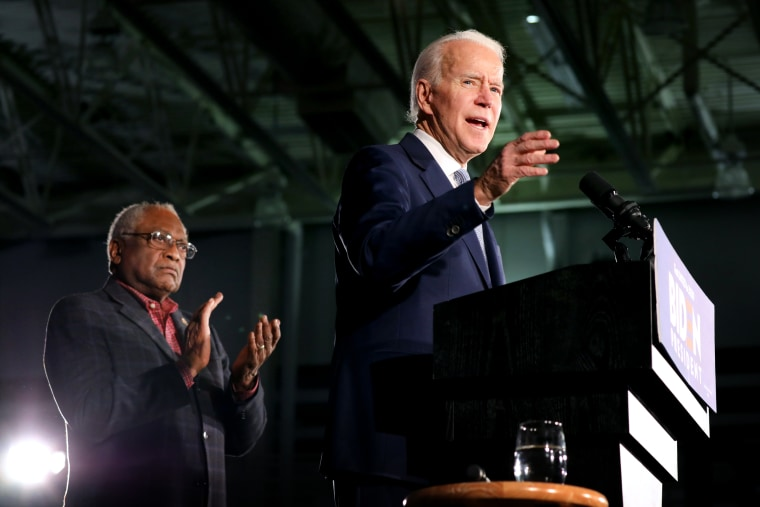 Image: Rep. Jim Clyburn, D-S.C., claps for Joe Biden at a primary event in Columbia, S.C., on Feb. 29, 2020.