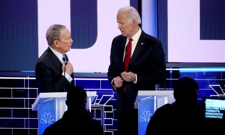 Image: Mike Bloomberg and Joe Biden speak during a break in the Democratic primary debate in Las Vegas on Feb.19, 2020.