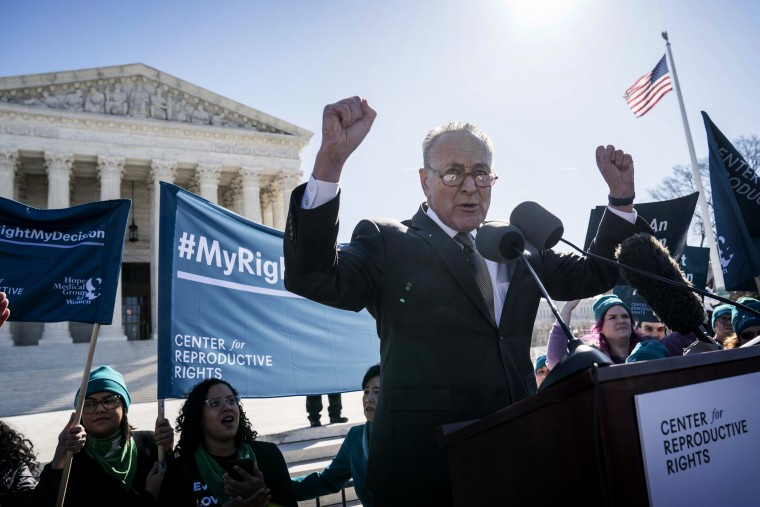 Image: Sen. Chuck Schumer, D-N.Y., speaks at a reproductive rights rally outside of the Supreme Court on March 4, 2020.