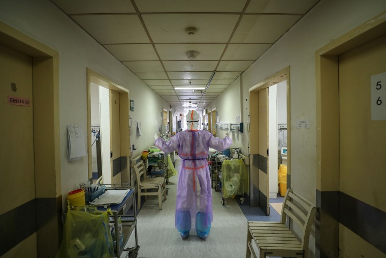 Image: A medical staff member doing stretch at the Red Cross hospital in Wuhan in China's central Hubei province