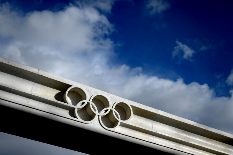 Image: The Olympic rings next to the IOC Headquarters in Lausanne, Switzerland, on Feb. 26, 2020.