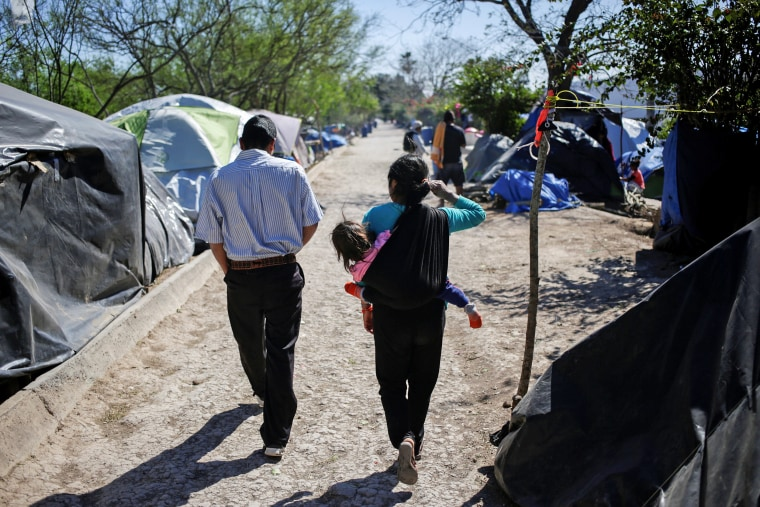Image: Migrants, asylum seekers sent back to Mexico from the U.S. under the Remain in Mexico program officially named Migrant Protection Protocols (MPP), are seen at provisional campsite near the Rio Bravo in Matamoros