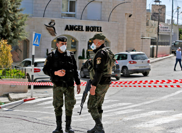 Image: Palestinian security forces seal off the Angel Hotel