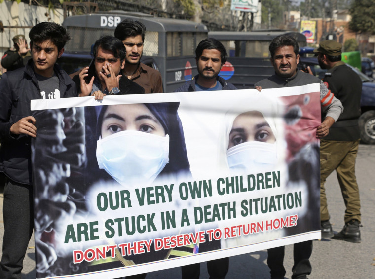 Image: Family members of Pakistani students studying in Wuhan, China, rally outside the Chinese Consulate for the evacuation of their relatives after the Chinese city was badly hit by the coronavirus, in Lahore, Pakistan