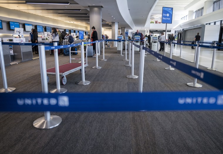 Travelers At SFO Airport As Airlines Face Crisis From Coronavirus
