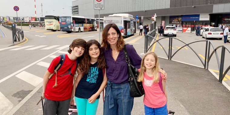 Cristina Higgins with her three children on family trip last summer.