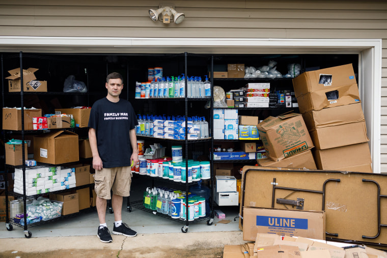 Image: Matt Colvin with his stock of hand sanitizer and other supplies in demand due to coronavirus concerns that he was selling online until Amazon and other sites started cracking down on price gouging, at his home in Hixson, Tenn., March 12, 2020. (Dou