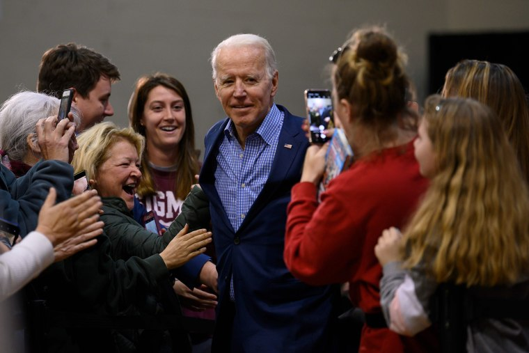 Image: Supporters cheer as Democratic presidential hopeful former Vice President Joe Biden (C) arrives to speak at a rally in Conway, South Carolina