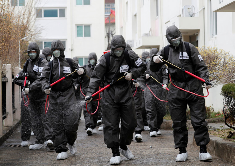 Image: South Korean soldiers spray disinfectants inside an apartment complex which is under cohort isolation after mass infection of coronavirus disease (COVID-19) in Daegu