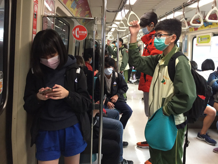 Image: Commuters travel on the subway in Taiwan.