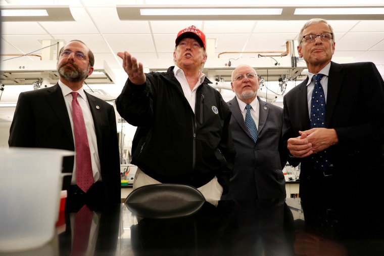 Image: President Donald Trump delivers remarks beside HHS Secretary Alex Azar and Centers for Disease Control, CDC Prevention Director Dr. Robert Redfield, and Associate Director for Laboratory Science and Safety Steve Monroe during a tour of the Center f