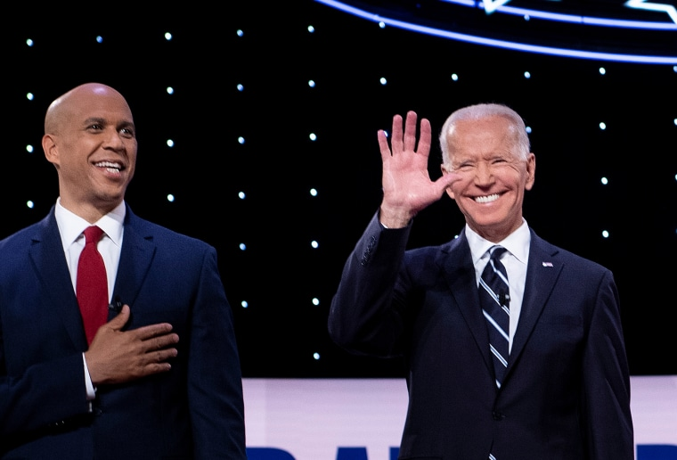 Sen. Cory Booker and former Vice President Joe Biden take the stage ahead of a Democratic debate in Detroit on July 31, 2019.