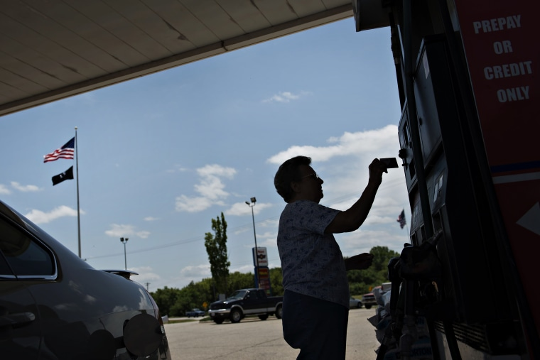 A customer pays for gas in Princeton, Ill.