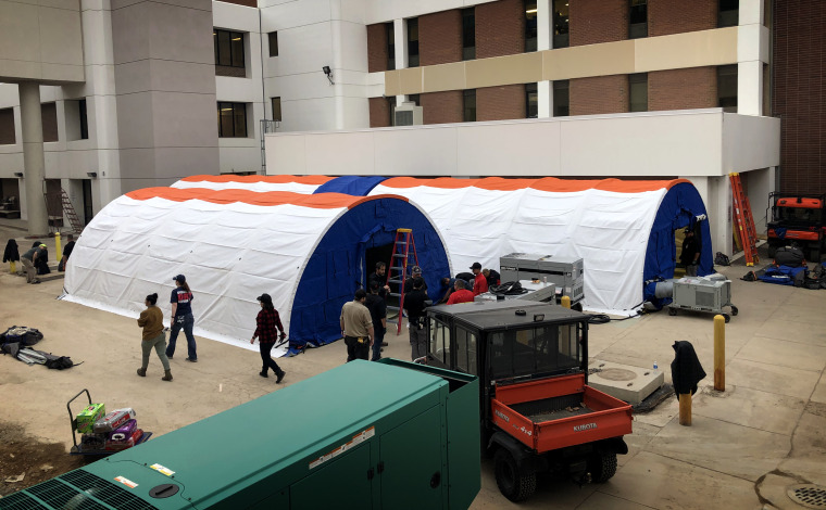 Image: The University of Utah Hospital erected two triage tents on Saturday where patients who are potentially infected with the new coronavirus can be tested without exposing everyone in the emergency room to the illness.