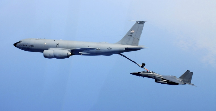 The U.S. Air Force's KC-135 refueling tanker and a F-15K fighter of South Korea's Air Force participate in a drill of aerial refueling