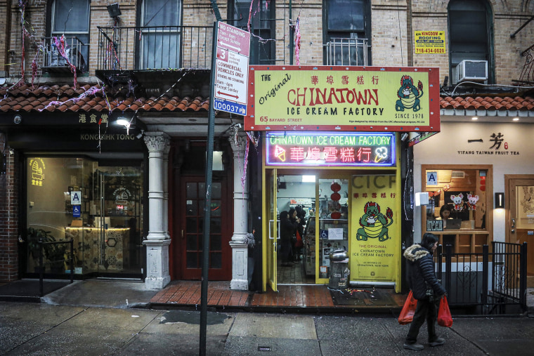 Image: A woman walks by Chinatown Ice Cream Factory