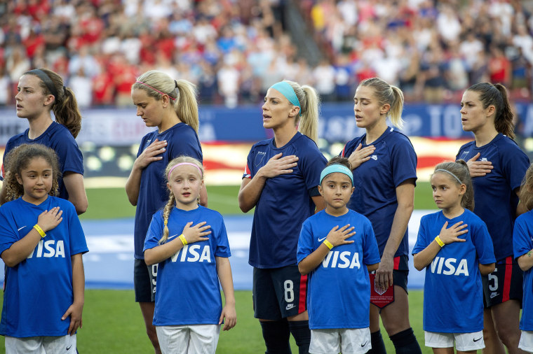 Image: U.S. players Tierna Davidson, Lindsey Horan, Julie Ertz, Abby Dahlkemper, and Kelley O'Hara stand with their jerseys turned inside out during the playing of the national anthem before a SheBelieves Cup women's soccer match against Japan