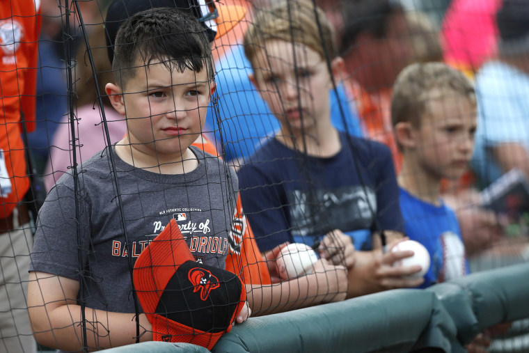 Image: Young fans looking for autographs react with disappointment after being told by a baseball player that he couldn't sign, prior to a spring training baseball game between the Baltimore Orioles and the Atlanta Braves