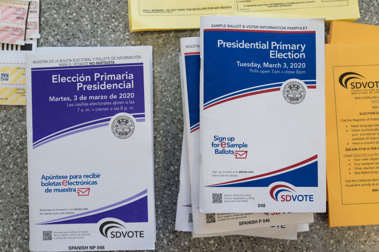 Image: English and Spanish-language sample ballots and voter information pamphlets for the California Democratic presidential primary are seen at a polling place in Del Mar, California
