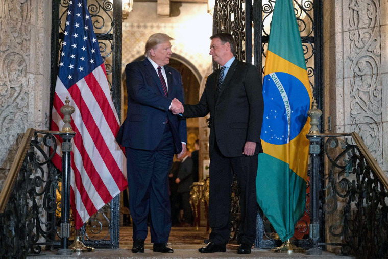 Image: President Donald Trump with Brazilian President Jair Bolsonaro at Mar-a-Lago in Palm Beach, Fla,