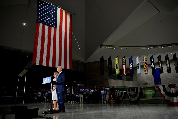 Joe Biden, flanked by his wife Jill Biden, speaks at the National Constitution Center in Philadelphia on March 10, 2020.
