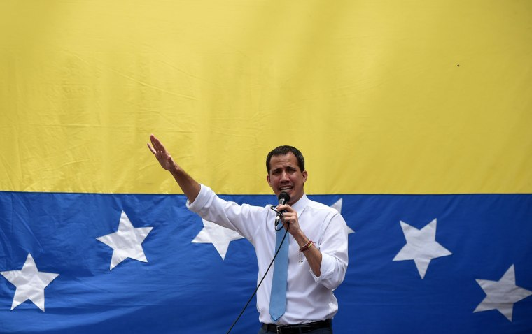 Image: Venezuelan opposition leader Juan Guaido addresses supporters during a street meeting within a demonstration heading to the National Assembly, in Las Mercedes, east Caracas