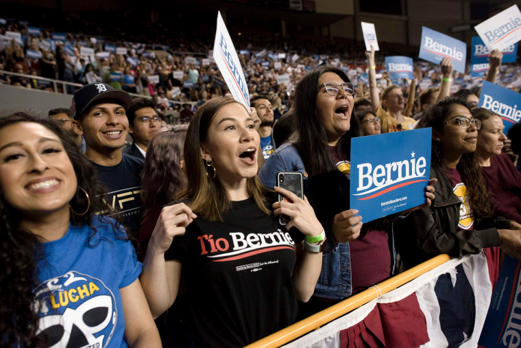 "Image: A supporter wears a shirt that says ""Tio Bernie"" during a rally for Sen. Bernie Sanders in Phoenix, Ariz., on March 5, 2020."