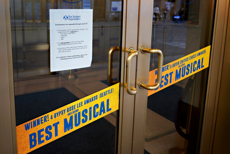 """Image: A sign announcing the theater for Broadway's \""""Come From Away\"""" is closed in New York on March 14, 2020. New York shuttered its iconic Broadway theaters as coronavirus continues to spread."""
