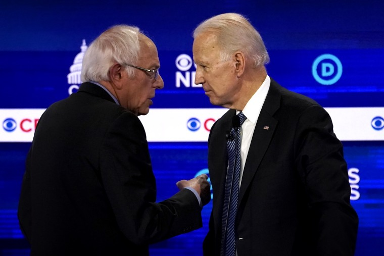 Image: Sen. Bernie Sanders and Joe Biden speak at a Democratic presidential debate on Charleston, S.C., on Feb. 25, 2020.