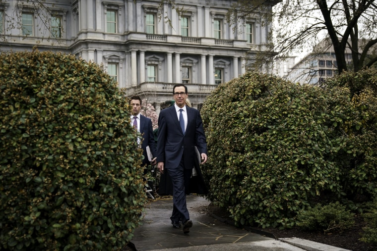 Image: Treasury Secretary Steve Mnuchin leaves a television interview outside of the White House on March 13, 2020.
