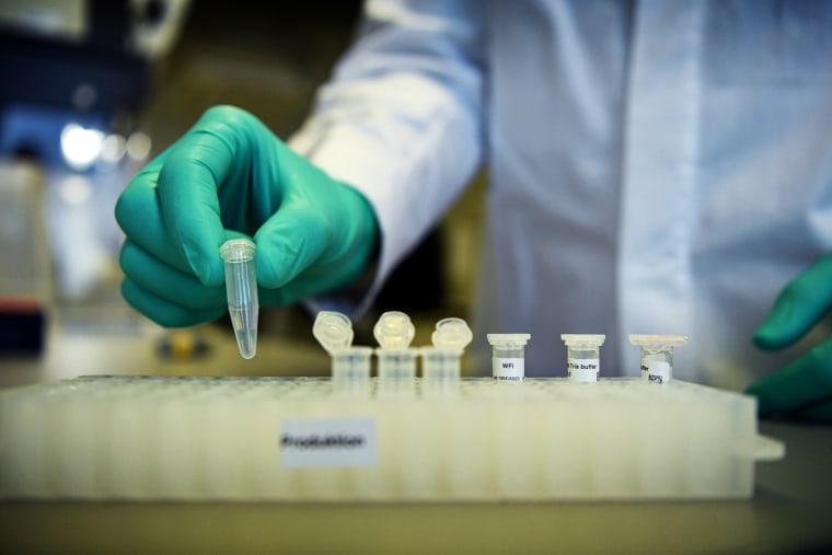 Image: A biopharmaceutical employee at CureVac demonstrates research for a coronavirus vaccine at a lab in Tuebingen, Germany, on March 12, 2020.
