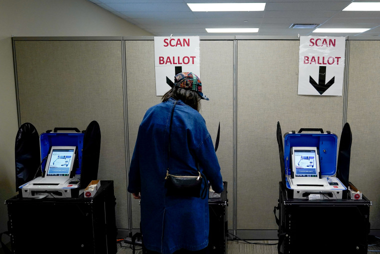 Image: A voter casts a ballot during early voting in Cincinnati, Ohio, on March 14, 2020.