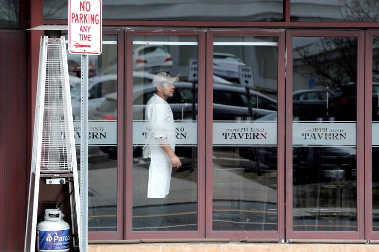Image: FILE PHOTO: A worker looks out from a near empty restaurant on North Avenue during the coronavirus outbreak in New Rochelle