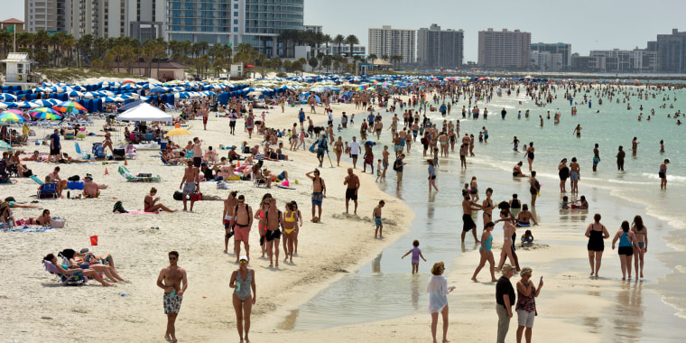 Image: FILE PHOTO: People crowd the beach, while other jurisdictions had already closed theirs in efforts to combat the spread of novel coronavirus disease (COVID-19) in Clearwater