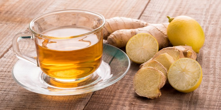 Close-Up Of Tea With Lemons And Ginger On Table