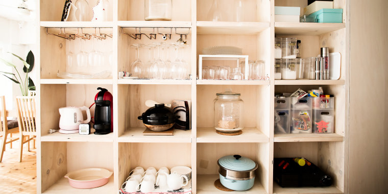 Wooden shelves with dishes arranged