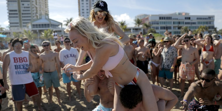 Spring break revelers during a game of chicken fight on Tuesday in Pompano Beach, Florida.