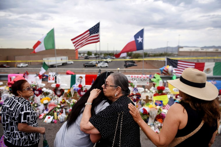 Image: People embrace at a memorial for the victims of a mass shooting in El Paso, Texas, on Aug. 6, 2019.