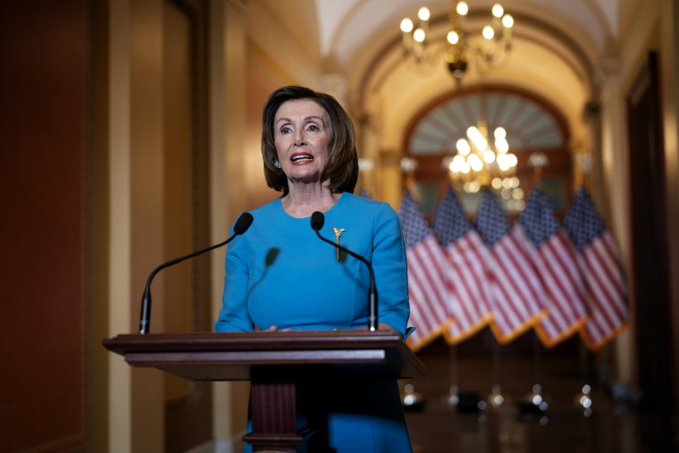 Image: Speaker of the House Nancy Pelosi makes a statement of the coronavirus aid package on Capitol Hill on March 13, 2020.