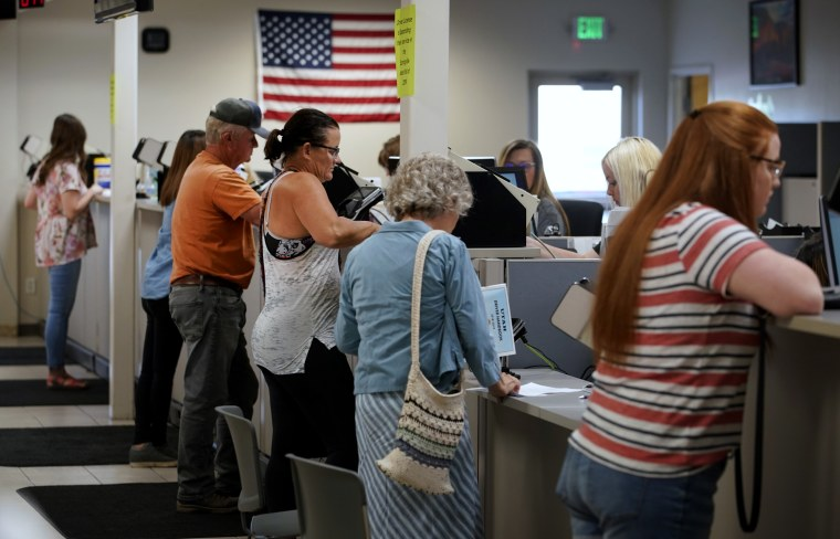 Image: People are helped at the Driver License Division in Orem, Utah, on July 9, 2019. The FBI and Immigration and Customs Enforcement have made thousands of searches using Department of Motor Vehicle databases in states like Utah, Vermont and Washington