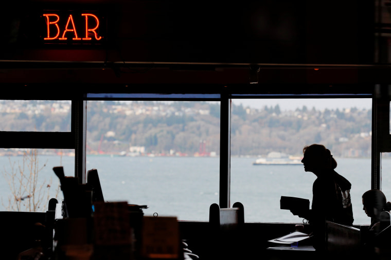 Image: A server works in the dining room of the Athenian Seafood Restaurant in Seattle