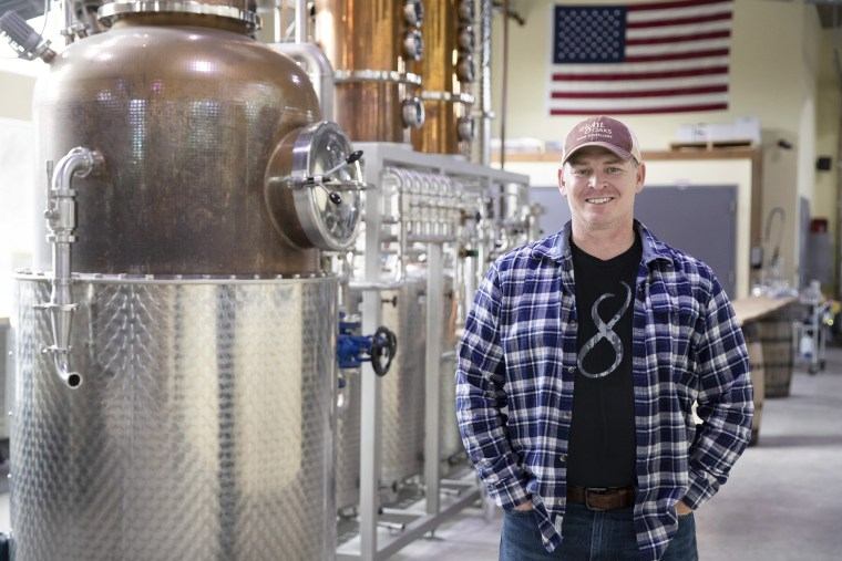 Image: Chad Butters, founder of Eight Oaks Farm Distillery, poses for a photo at their facility in New Tripoli