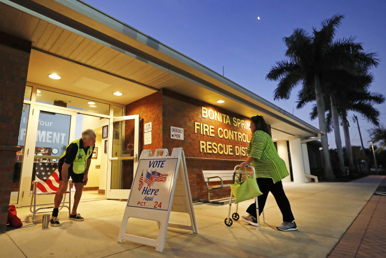 A voter walks into a polling station for the Florida presidential primary, Tuesday, March 17, 2020, in Bonita Springs, Fla.